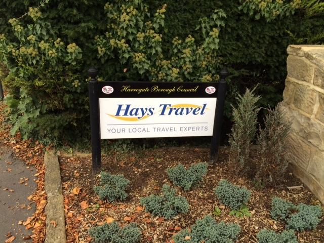 Hays Travel Pavement Sign